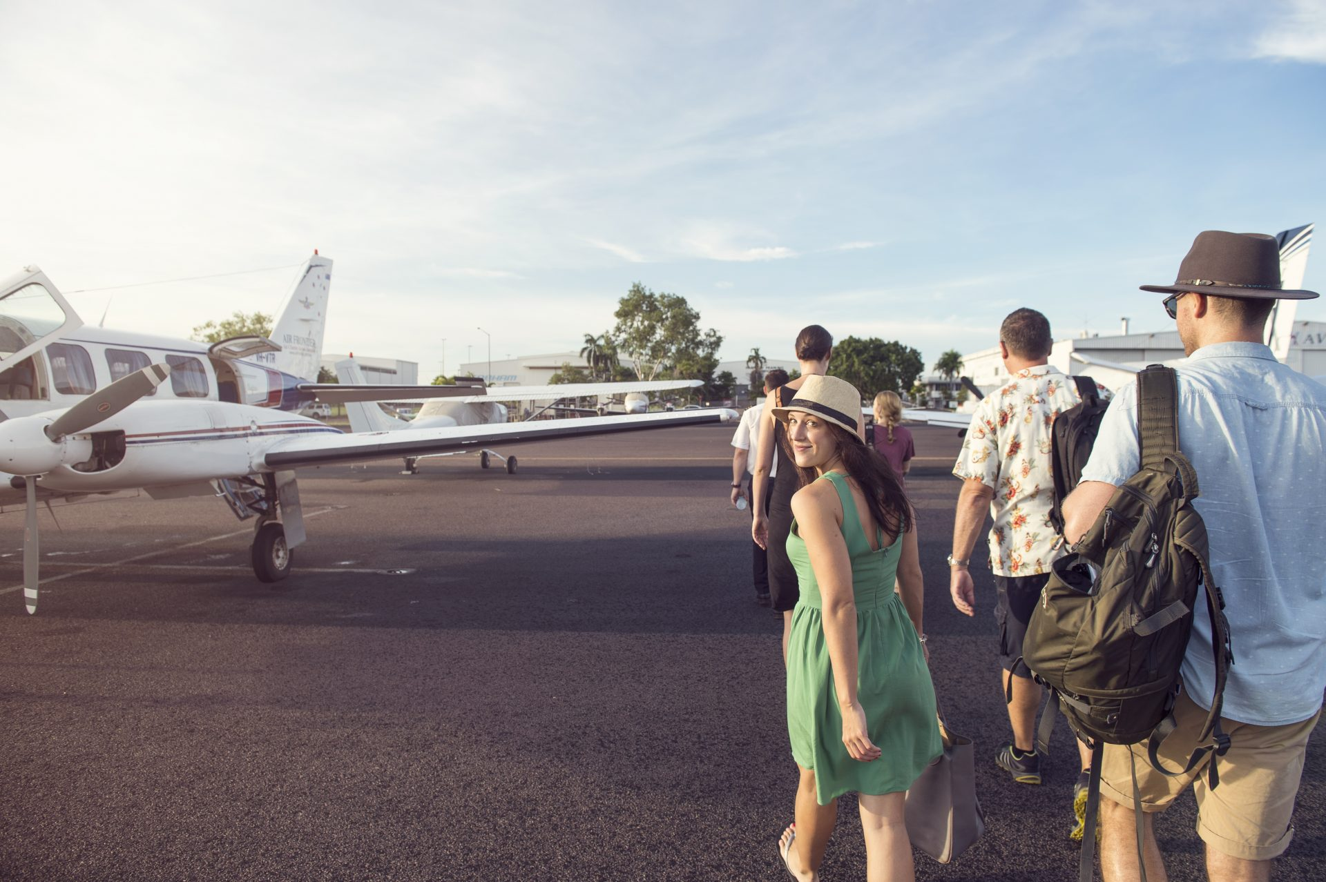 A group of visitors board a connecting flight to Tiwi Islands.
